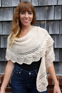 Free Pattern F767 Worsted Merino Superwash Cabled Edge Shawl. This one is perfect for the girl who has everything. Whether it's a night out on the town or a trip to the mall, this versatile and beautifully detailed shawl is a must for any wardrobe.